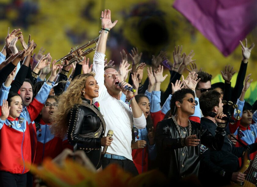 SANTA CLARA, CA - FEBRUARY 07: Beyonce, Chris Martin of Coldplay and Bruno Mars perform during the Pepsi Super Bowl 50 Halftime Show at Levi's Stadium on February 7, 2016 in Santa Clara, California. (Photo by Patrick Smith/Getty Images) ** OUTS - ELSENT, FPG, CM - OUTS * NM, PH, VA if sourced by CT, LA or MoD **