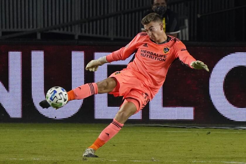 Galaxy goalkeeper Jonathan Klinsmann kicks the ball during a match