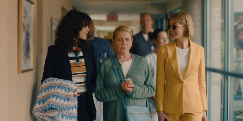 """Eiza González, Dianne Wiest and Rosamund Pike in a scene from the movie """"I Care a Lot."""""""
