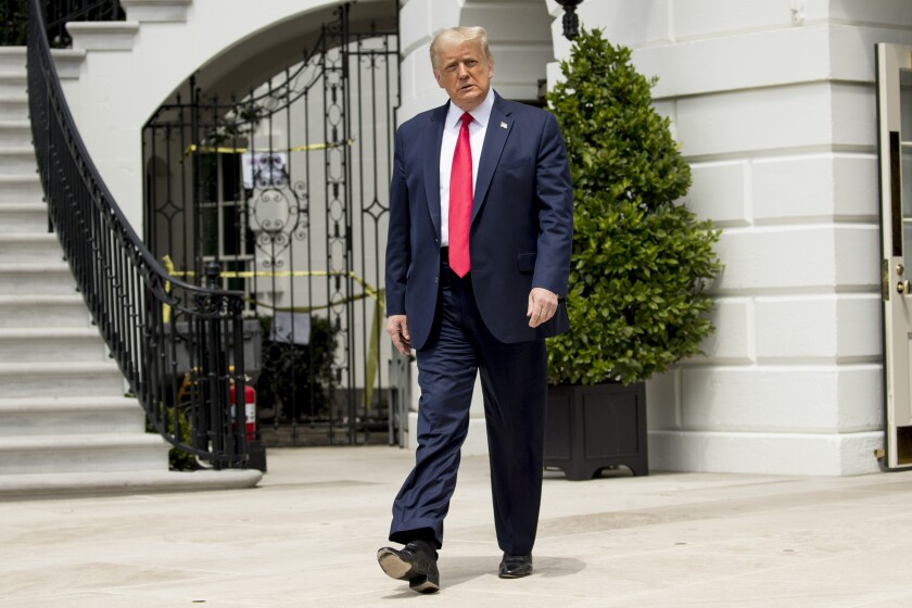 President Donald Trump leaves the White House Thursday before boarding Marine One for a trip to Andrews Air Force Base.