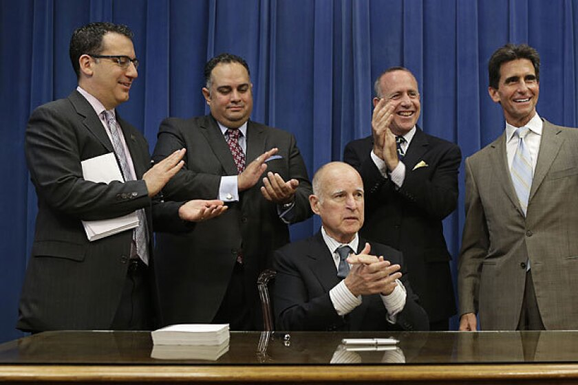 Assemblyman Bob Blumenfield (D-Woodland Hills), left, Assembly Speaker John Perez (D-Los Angeles), Senate President Pro Tem Darrell Steinberg (D-Sacramento) and Sen. Mark Leno (D-San Francisco) applaud after receiving a copy of the state budget presented by Gov. Jerry Brown last year.