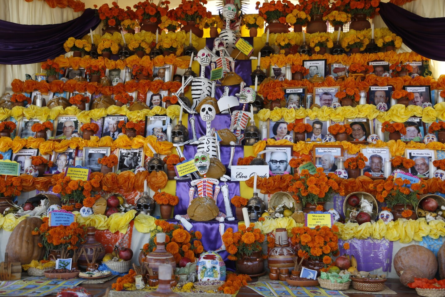 Mercado Hidalgo in Tijuana celebrates the Day of the Dead with a large altar and Pre-Columbian dancers.