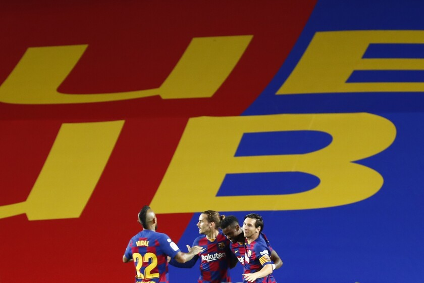 FC Barcelona's Antoine Griezmann, second left, celebrates after scoring his side's second goal during the Spanish La Liga soccer match between FC Barcelona and Leganes at the Camp Nou stadium in Barcelona, Spain, Tuesday, June 16, 2020. (AP Photo/Joan Montfort)