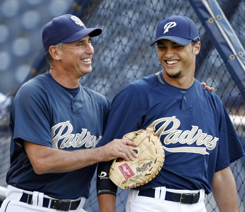 Padres manager Bud Black and Donavan Tate shared a laugh before a 2009 game, shortly after Tate was drafted No.3 overall, back before things started going awry. (Sean M. Haffey / Union-Tribune)