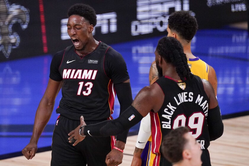 Miami Heat forward Bam Adebayo celebrates after scoring against the Los Angeles Lakers during the first half in Game 4 of basketball's NBA Finals Tuesday, Oct. 6, 2020, in Lake Buena Vista, Fla. (AP Photo/Mark J. Terrill)