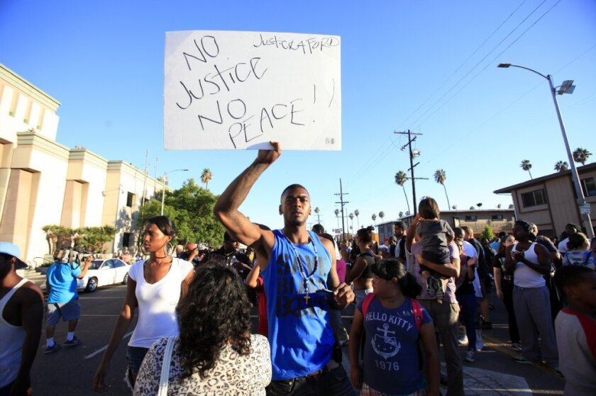 Lavell Ford joined 200 others activists who marched downtown on Thursday to protest the fatal police shooting of his brother, Ezell Ford, an unarmed mentally ill man.  (Francine Orr/ Los Angeles Times)