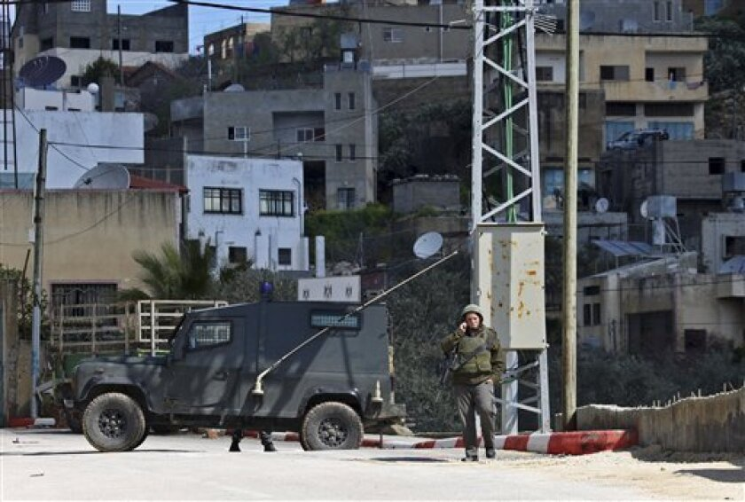 Israeli troops operate in the West Bank village of Awarta, after five people were killed in the nearby Jewish settlement of Itamar Saturday, March 12, 2011. A Palestinian infiltrated Itamar early Saturday and killed five people, the Israeli military said.  Israeli media is reporting that the dead a