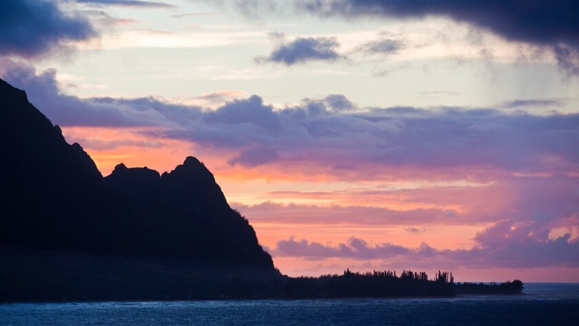 Glorious sunsets, such as this one behind Hanalei Bay, are just one of many attractions on the island of Kauai.