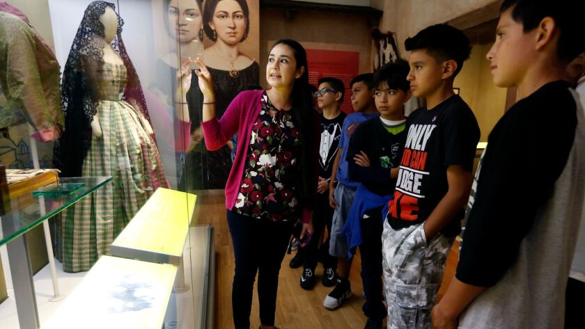 Gina Alicia López Ramos gives a tour of La Plaza de Cultura y Artes to students visiting from South