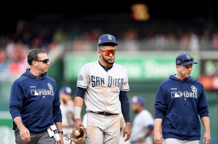The decision by Padres manager Andy Green (right) to rest rookie Fernando Tatis Jr. (center) last Saturday night against the Nationals at Petco Park didn't make sense.