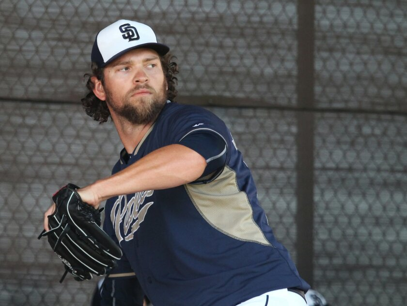 Padres pitcher Josh Johnson throws his first bullpen session since his Tommy John surgery last April.