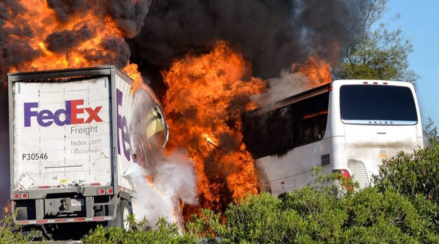 Flames engulf the vehicles just after a head-on crash near Orland, Calif., involving a FedEx truck and a bus carrying Los Angeles-area high school students on a visit to a college.
