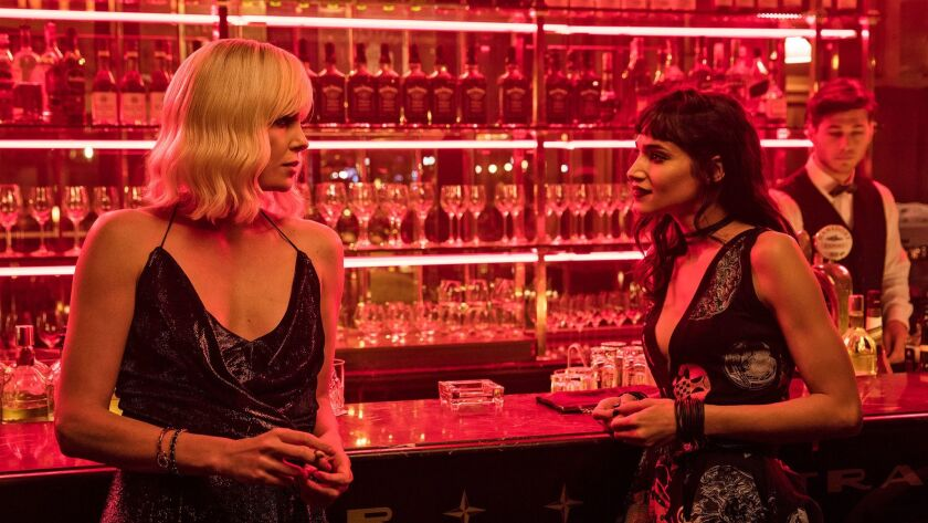 "Charlize Theron as Lorraine Broughton and Sofia Boutella as Delphine Lasalle in ""Atomic Blonde."""