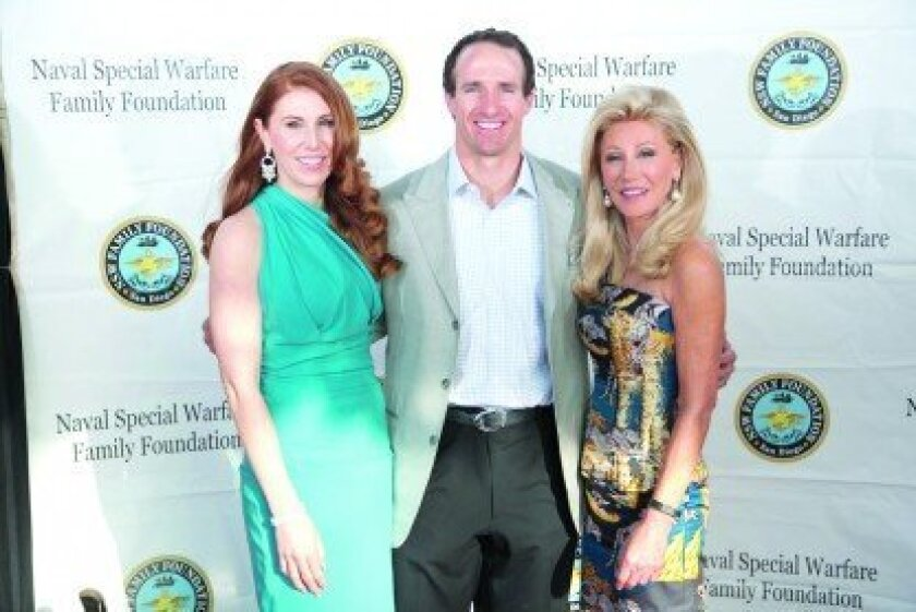 Co-Chairs Dominique Plewes and Madeleine Pickens with New Orleans Saints quarterback Drew Brees. Elegant Photography