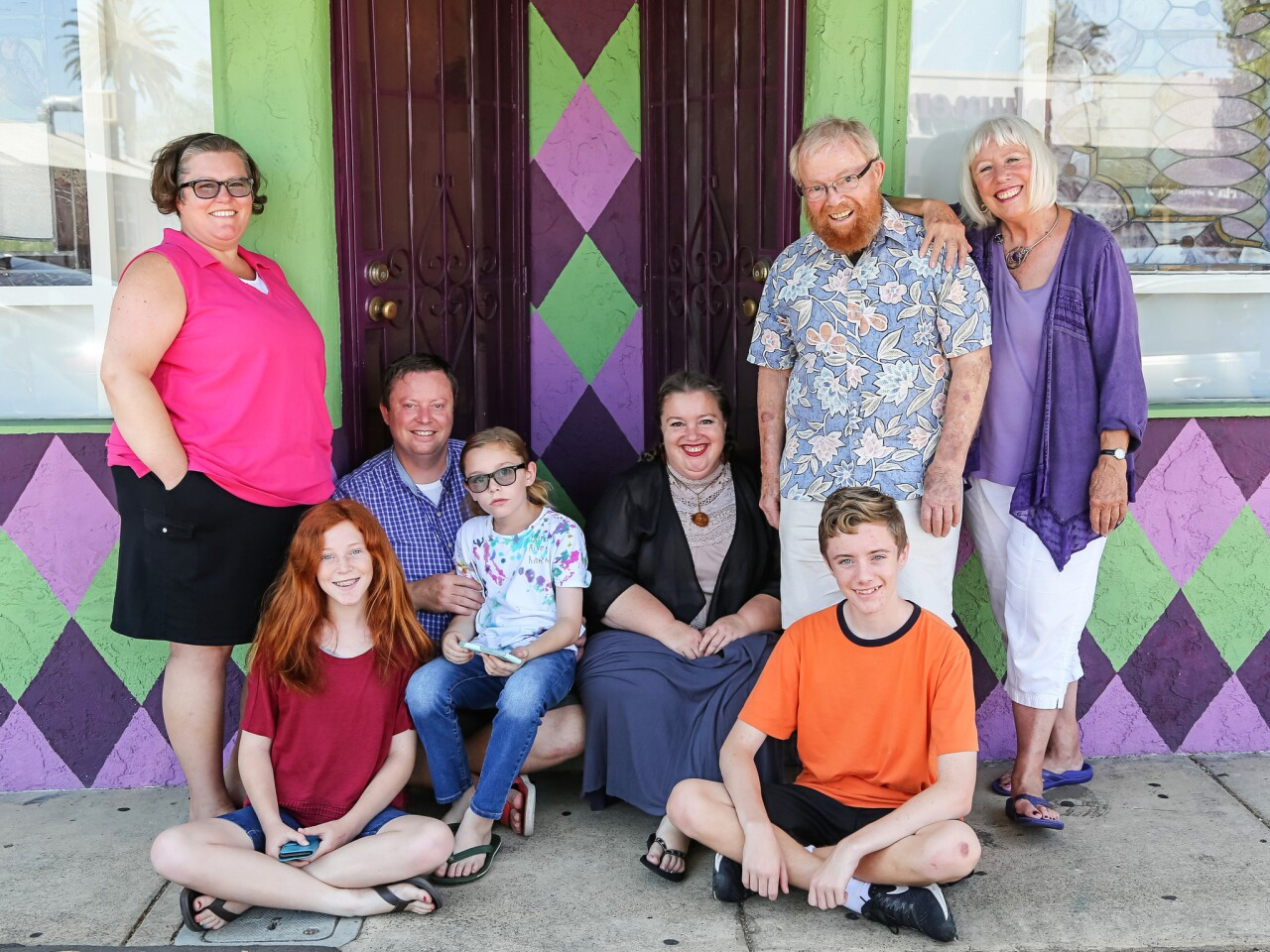 The Haven clan in front of their San Diego apartment building includes, from left, Carla (standing), Molly, 13, dad Matthew, 12-year-old Nate, Amy, 15-year-old Chris and grandparents Clayton and Sharon.