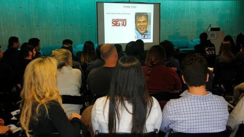 Students and members of Junior Seau's family listen to a talk by UC San Diego neurobiology professor Gentry Patrick on Wednesday. (K.C. Alfred)