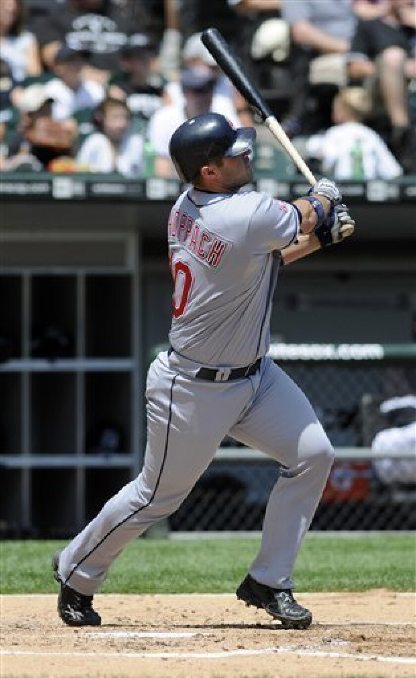 Cleveland Indians Kelly Shoppach hits a grand slam during the second inning of a baseball game against the Chicago White Sox Thursday, July 9, 2009, in Chicago. (AP Photo/David Banks)