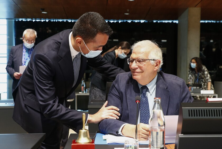 Italy's Foreign Minister Luigi Di Maio, left, talks to European Union foreign policy chief Josep Borrell during a European Foreign Affairs Ministers meeting at the European Council building in Luxembourg, Monday, June 21, 2021. EU foreign ministers were set to approve Monday a new set of sanctions against scores of officials in Belarus and prepare a series of measures aimed at the country's economy. (Johanna Geron/Pool Photo via AP)