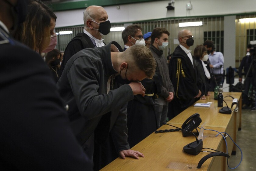 Finnegan Lee Elder listens as the verdict is read, in the trial for the slaying of an Italian plainclothes police officer in summer 2019, in Rome, Wednesday, May 5, 2021. A jury in Rome on Wednesday convicted two American friends in the 2019 slaying of a police officer in a drug sting gone awry, sentencing them to life in prison. The jury deliberated more than 12 hours before delivering the verdicts against Finnegan Lee Elder, 21, and Gabriel Natale Hjorth, 20, handing them Italy's stiffest sentence. (AP Photo/Gregorio Borgia)