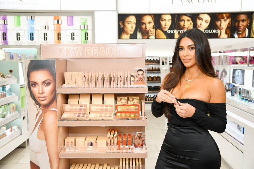 Kim Kardashian appeared Thursday on Chinese influencer Viya's livestream to promote her signature KKW fragrances.