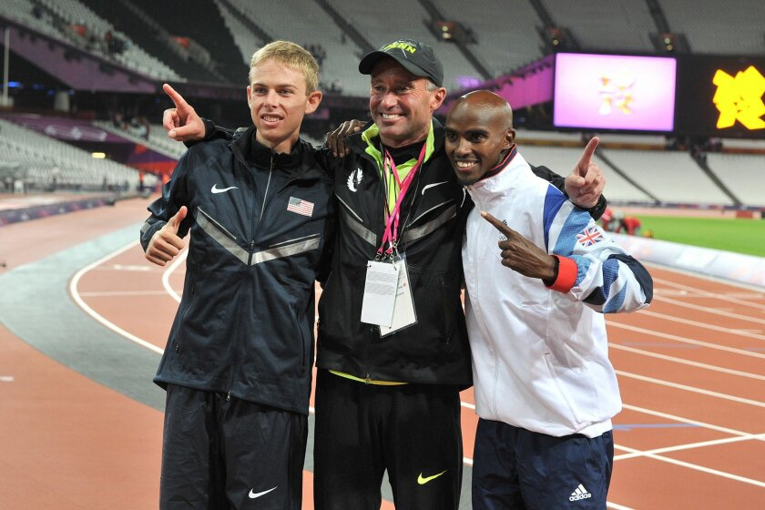 FILE - In this Aug. 4, 2012 file photo, Britain's Mo Farah, right, celebrates winning the men's 10,000m final with silver medalist USA's Galen Rupp, at left and coach Alberto Salazar, during the Olympics held in London. The Associated Press has learned the U.S. Anti-Doping Agency is investigating whether track coach Alberto Salazar encouraged star runner Galen Rupp and others to skirt anti-doping rules. A person with knowledge of the investigation told AP on Wednesday, June 24, 2015 that more than a dozen witnesses have been interviewed and USADA is actively pursuing documents and other evidence from Salazar, who coached Rupp to the silver medal in the 10,000 meters at the London Olympics. The person spoke on condition of anonymity because anti-doping investigations are considered confidential. (Martin Rickett/PA, via AP, File) UNITED KINGDOM OUT