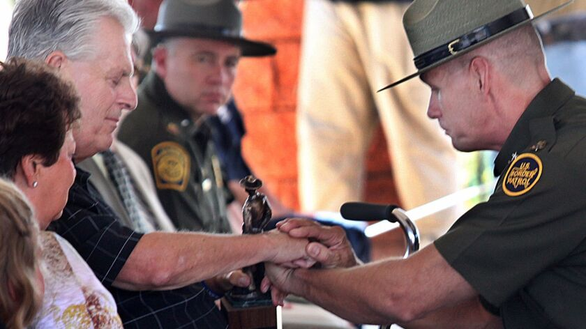 """Kent Terry Sr., father of Border Patrol Agent Brian Terry, and Richard """"Rick"""" Barlow, chief patrol a"""