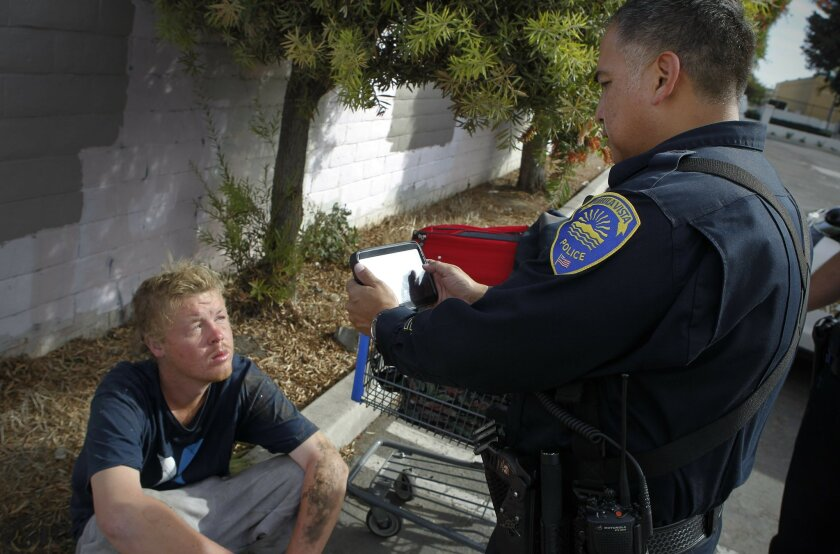 Chula Vista police Officer Roman Granados uses a computer tablet equipped with facial recognition software to photograph a person while on patrol. The photo is uploaded to a database which searches for possible matches. Once possible matches are found, Granados compares the photos to make the fina