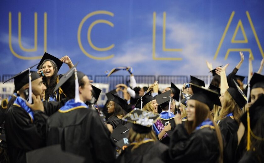 Graduates of UCLA wave to friends and family before the start of commencement ceremonies in June 2013.