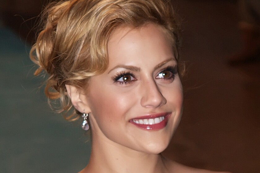 A closeup of Brittany Murphy's face