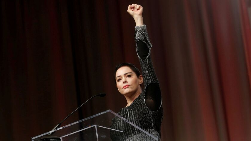 FILE PHOTO: Actor McGowan raises her fist after addressing the audience during Women's Convention in Detroit