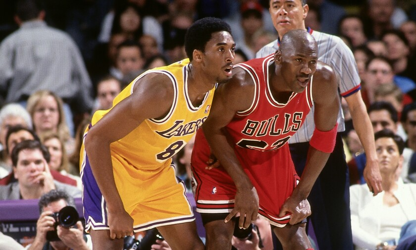 Kobe Bryant and Michael Jordan stand next to one another during a game.
