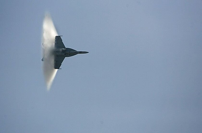 An F/A-18 Super Hornet gets close to breaking the sound barrier at the 2010 Miramar Air Show.