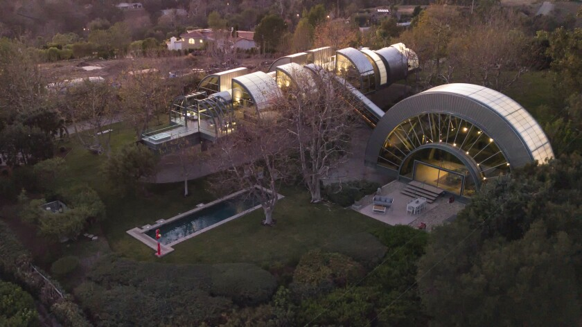 The two-acre estate features a skybridge that connects a 35-foot great room to a long, slender home