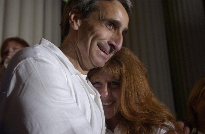 Kenneth Marsh embraced Brenda Buell Warter on the steps of the San Diego Hall of Justice after his release in August 2004. Marsh was convicted in 1983 of killing the son of Warter, his girlfriend at the time. A judge later granted his habeas corpus petition. [Union-Tribune file]