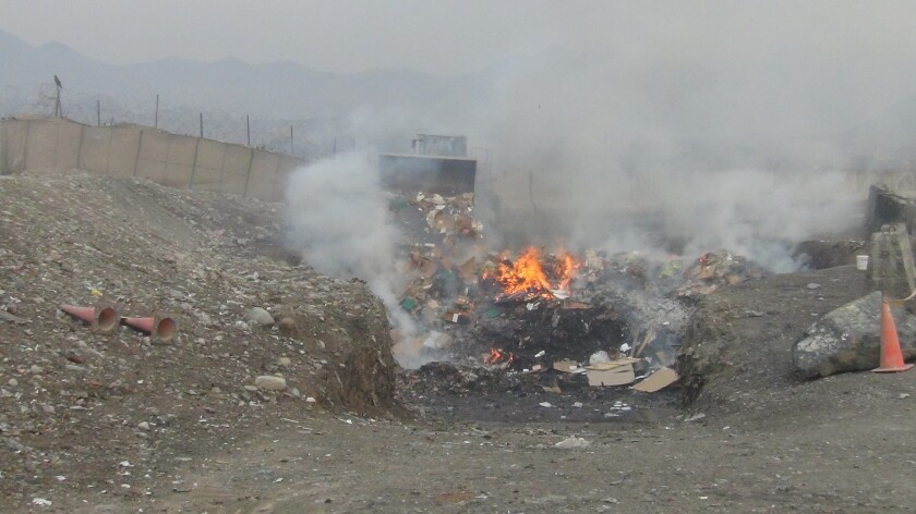 Trash burns in an open pit in Afghanistan.