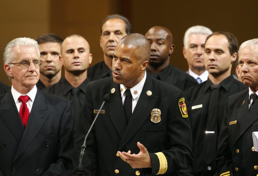 Fire Chief Brian Cummings, center, speaking Tuesday at City Hall in downtown Los Angeles.
