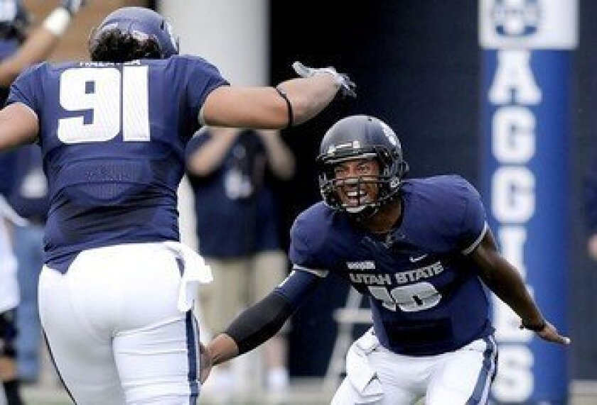 The Aggies need tight end D.J. Tialavea (91) to become a solid receiver for QB Chuckie Keeton in 2013