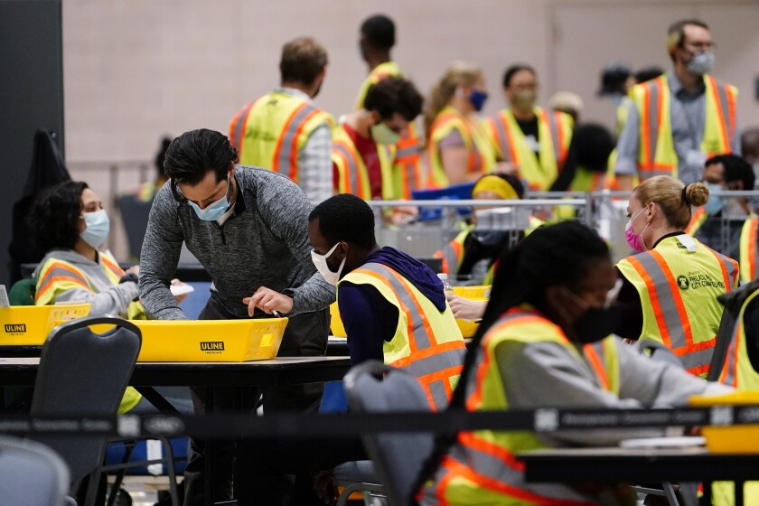 Philadelphia election workers process mail-in and absentee ballots at the Pennsylvania Convention Center.