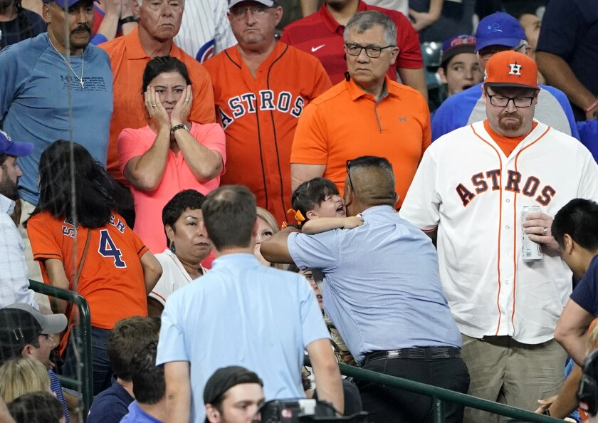 FILE - In this Wednesday, May 29, 2019, file photo, a young child is carried from the stands after being injured by a foul ball off the bat of Chicago Cubs' Albert Almora Jr. during the fourth inning of a baseball game against the Houston Astros, in Houston. A 2-year-old girl struck by a foul ball during a Houston Astros game at Minute Maid Park continues to receive anti-seizure medication seven months after suffering a brain injury that could leave her at risk of seizures for life, an attorney for her family said. In a report posted Tuesday, Jan. 7, 2020 Richard Mithoff told the Houston Chronicle that the child's brain injury is permanent.. (AP Photo/David J. Phillip, File)