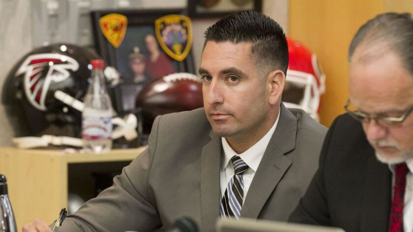 Deputy Richard Fischer, shown here in a Vista courtroom, was ordered to stand trial on 15 counts related to accusations of groping women under color of authority.