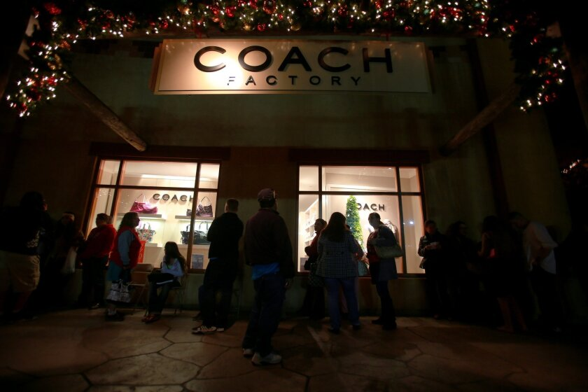 U-T File: In this Nov. 22, 2012 photo, shoppers lined up outside the Coach Factory store at the Viejas Outlet Mall when stores opened Thursday evening at 6 p.m. This year, even more retailers plan to open their doors on Thanksgiving Day.