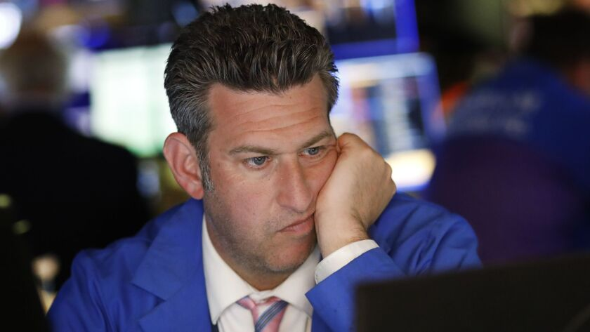 A trader watches a screen at the New York Stock Exchange, Monday, May 13, 2019 in New York. U.S. sto