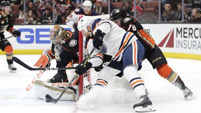 Ducks goaltender John Gibson stops a shot by Edmonton's Zack Kassian during the first period Sunday.