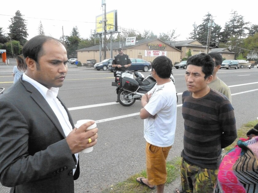 Som Subedi, left, asks fellow Bhutanese immigrant Ash Monger about a car accident Monger witnessed in Portland, Ore., involving another refugee from the mountain nation.