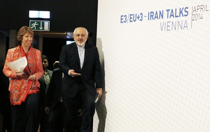 Iran is complying with the terms of an interim nuclear deal with six foreign powers by diluting or converting its stockpile of enriched uranium, IAEA officials confirmed Wednesday. Above, Iranian Foreign Minister Mohammad Javad Zarif and European Union foreign affairs chief Catherine Ashton attend talks in Vienna last week aimed at a permanent nuclear accord.