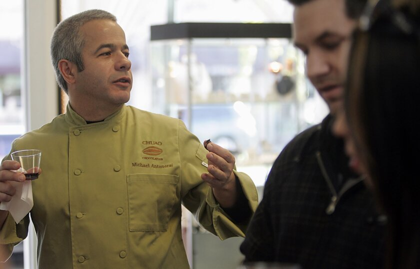 """""""Chocolate is a magical thing. It's very sensual. It triggers pleasure hormones in the body and it excites you and alerts your senses,"""" said chocolatier Michael Antonorsi (left). Ryan Keefer and Bridget Jordan test this out at the festival in downtown Escondido."""