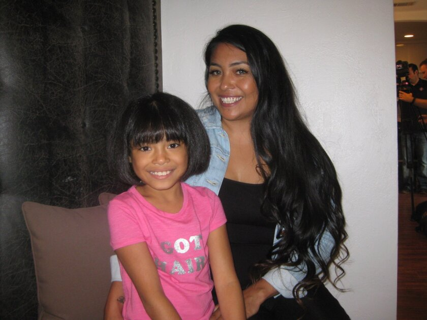 Gabriella 'Ella' Martinez with her mother, Erica, after ella donated 12 inches of hair to Wigs For kids.