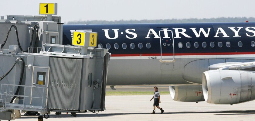 A US Airways plane sits next to the terminal at Will Rogers World Airport in 2006 after it was diverted to Oklahoma City because of an incident involving a disruptive passenger.