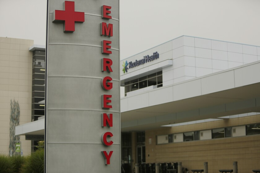 FILE - In this Sept. 10, 2021, file photo, an emergency department sign is photographed at Kootenai Health, in Coeur d'Alene, Idaho. Washington is facing its own COVID-19 crisis and has little capacity to help neighboring Idaho deal with an overwhelming surge of cases driven by unvaccinated people, state hospital executives and doctors said Monday, Sept. 13, 2021. (AP Photo/Young Kwak,FileS)