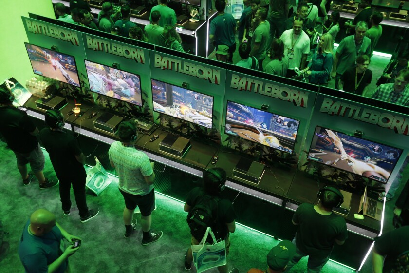 Video games are hot but playing to the same old crowd. Where's the future?